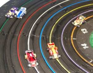 Leader Turn Two Racing Action