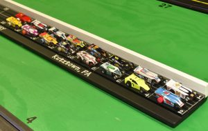 The field of 16 cars ready for the drivers to start their engines